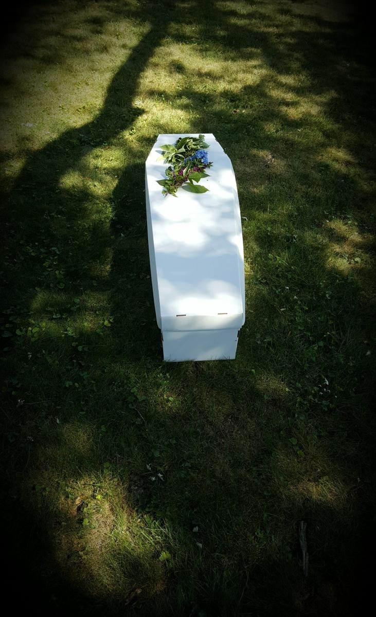 white biodegradable coffin